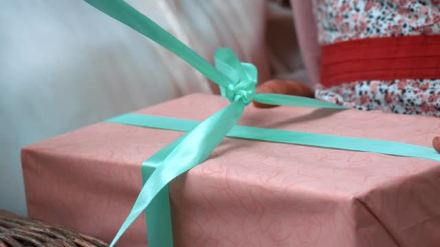 unwrapping presents - birthday gift stock videos & royalty-free footage