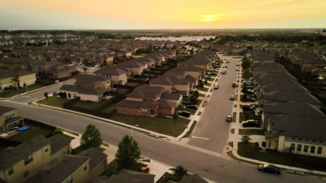 up and away sunset over modern suburb homes - modern rock stock videos & royalty-free footage