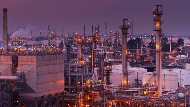 up and over an oil refinery - aerial shot - port of los angeles stock videos & royalty-free footage
