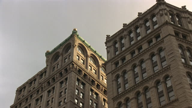 up angle of 41 park row, a multi-story romanesque style office building in manhattan. could be upper class apartment building or condominiums.