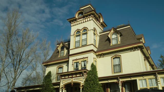 up angle of multi-story victorian house.