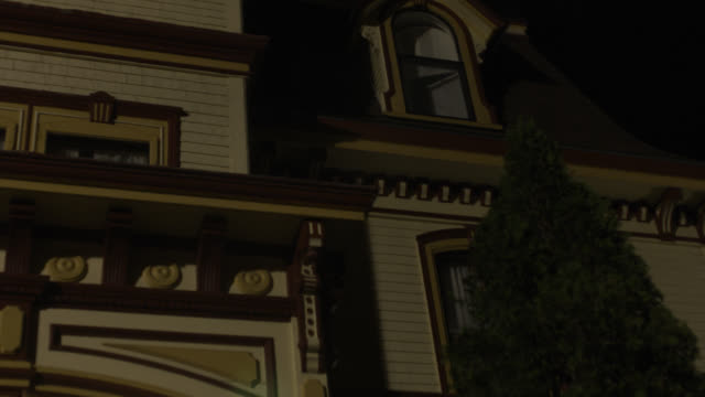 up angle of second story window of multi-story victorian house.