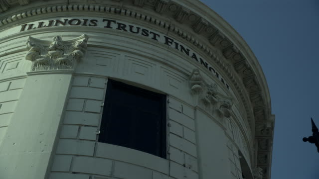up angle of window on illinois trust financial office building. could be bank. - financial building stock videos and b-roll footage