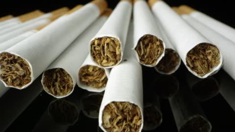 up close macro shot panning across cigarettes - dålig vana bildbanksvideor och videomaterial från bakom kulisserna