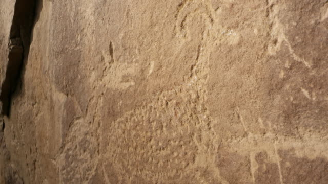up close panning view of ancient petroglyph carvings - anasazi stock videos & royalty-free footage