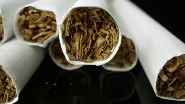 up close shot of cigarettes viewing the tobacco - nikotin stock-videos und b-roll-filmmaterial