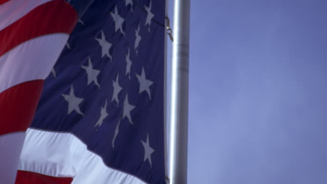 up close shot of the american flag blowing in the wind. - プロボ点の映像素材/bロール