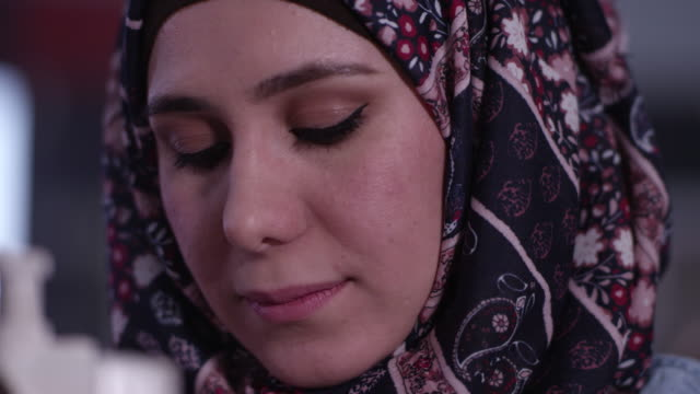 up close view of ethnic woman wearing a headscarf - made in the usa short phrase stock videos & royalty-free footage