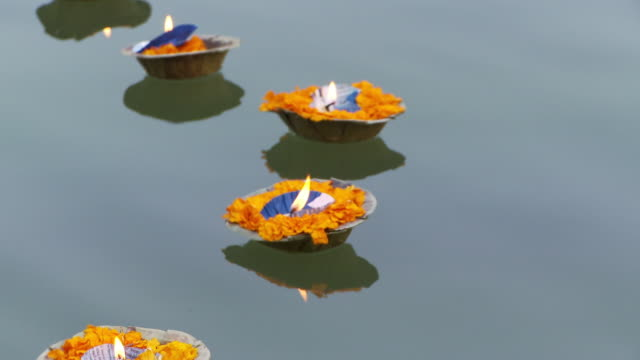 Up close view of floating candles in river