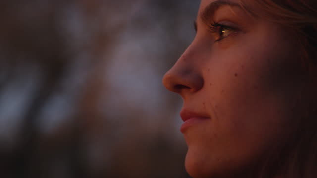 Up close view of teenage girls face at dusk