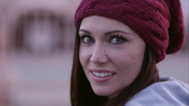 up close view of woman turning to camera and smiling. - woolly hat stock videos and b-roll footage