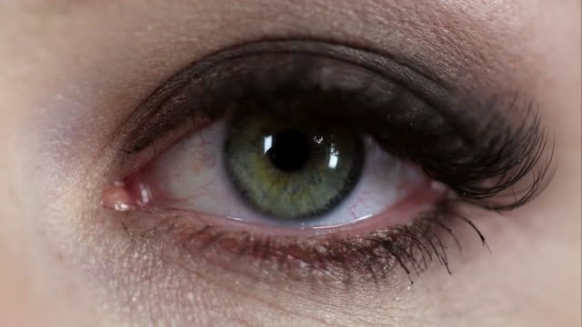 up close view of woman's eye - concepts & topics stock videos and b-roll footage