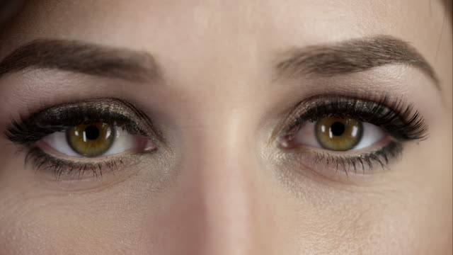 Up close view of woman's eyes blinking