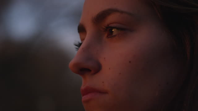 Up close view of womans face at dusk