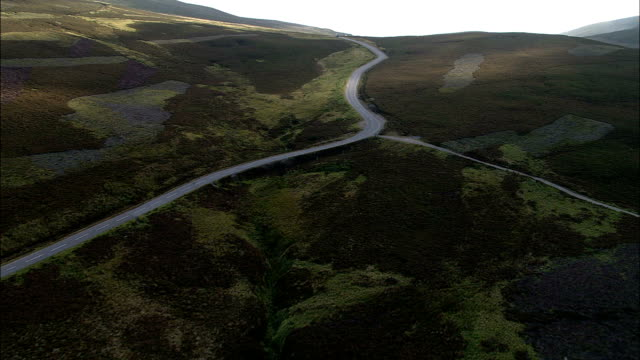 up old military road now a939  - aerial view - scotland, aberdeenshire, united kingdom - moor stock videos & royalty-free footage
