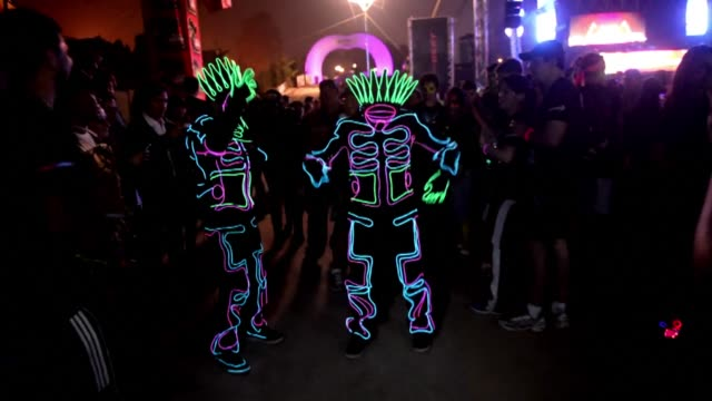 up to 5,000 enthusiasts don neon costumes to take part in the five kilometre neon run in guatemala city. clean : runners light up the guatemala sky... - kilometre stock videos & royalty-free footage