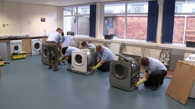 Up to one million fire hazard Whirlpoolmade tumble dryers still in use in UK homes report says INT Various of trainee engineers working on tumble...