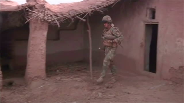 update on 'operation black prince'; afghanistan: helmand province: ext / dusk reporter to camera cutaway sequence showing afghanistan national army... - international security assistance force stock videos & royalty-free footage