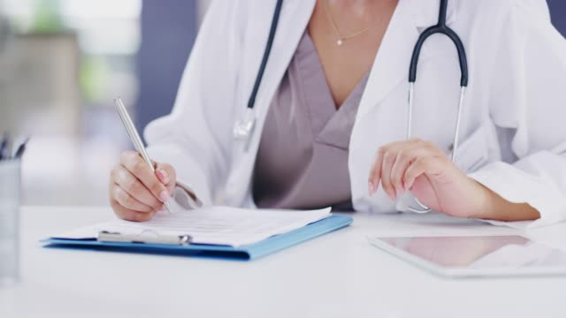 updating her patients' medical records - medical record stock videos & royalty-free footage