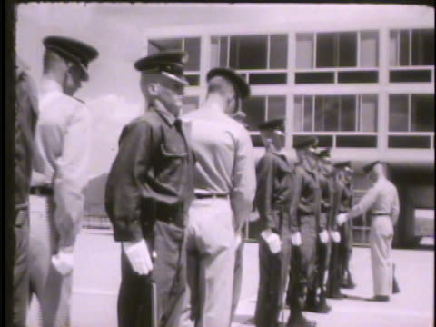 upper classmen officers checking uniforms of new cadets standing at attention outdoors colorado co rampart range basic training cadet area drills - cadet stock videos & royalty-free footage