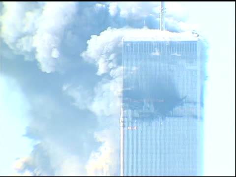 9/11/01 MS upper levels of WTC Towers moments before Tower 2 collapses Building water supply tanks on rooftops in FG Cameraman says Oops and mentions...