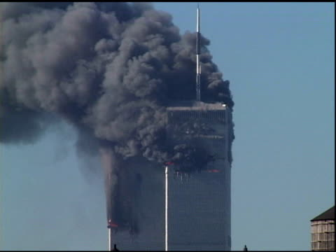 9/11/2001 ms upper levels of wtc towers on fire lots of dark smoke after both planes hit towers 1 2 shot from manhattan rooftop - world trade center manhattan video stock e b–roll