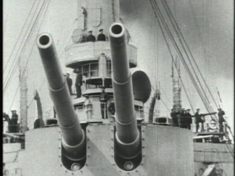 vídeos de stock e filmes b-roll de two battleships following, two deck cannons changing position slightly. russian czar nicolas ii w/ unidentified officer, walking onto ship deck,... - world war ii
