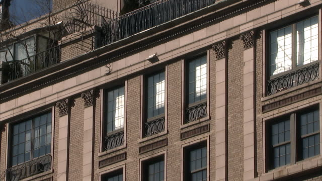 ms zi upper windows of 133 e 64th street, the former home of bernard madoff / new york city, new york, usa  - former stock videos & royalty-free footage