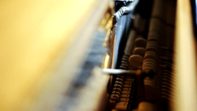 Upright Piano Hammers Hitting Strings