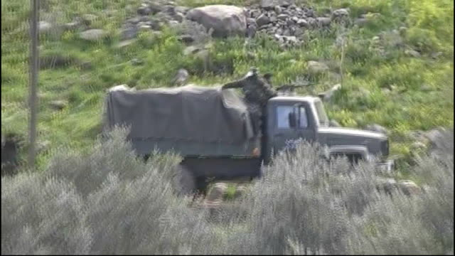 Amnesty International accuses Presidend Assad's regime of torture SYRIAN / LEBANESE BORDER EXT Syrian army truck reversing near to border area Syrian...