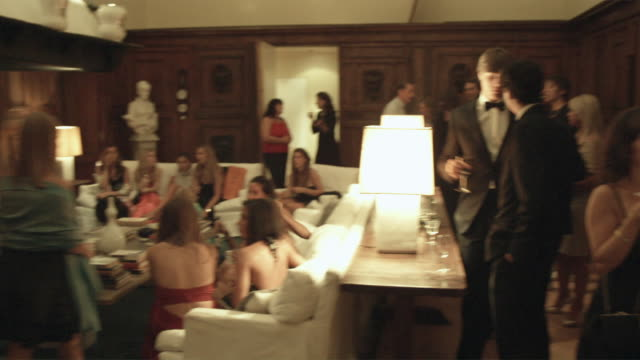 ws pan upscale party in luxurious home / rome, italy - formal stock videos and b-roll footage