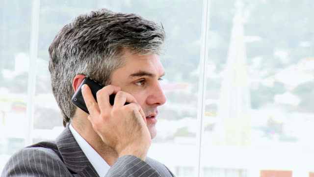 CU Upset businessman talking on phone / Cape Town, Western Cape, South Africa