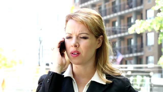 Upset businesswoman talking on cellphone