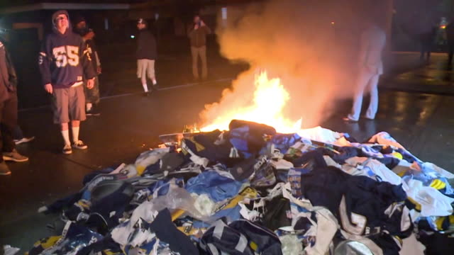 KSWB Upset Chargers fans set fire to a pile of memorabilia outside the team headquarters in Costa Mesa following owner Dean Spanos' announcement the...