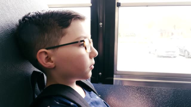 upset elementary age schoolboy on school bus - first day of school stock videos & royalty-free footage