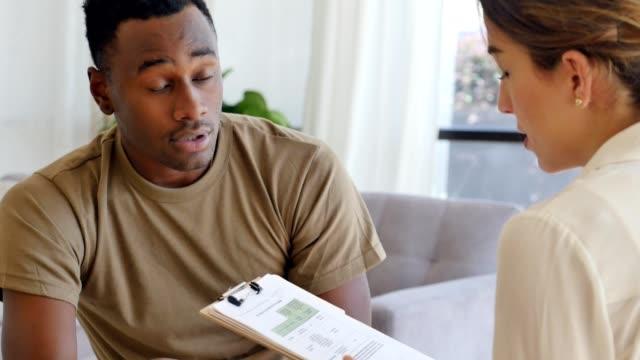 Upset male military veteran talks with psychiatrist