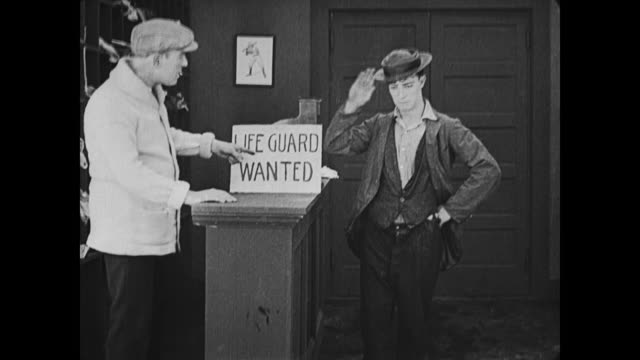 1917 upset man (buster keaton) applies for lifeguard job at bathhouse - help wanted sign stock videos and b-roll footage