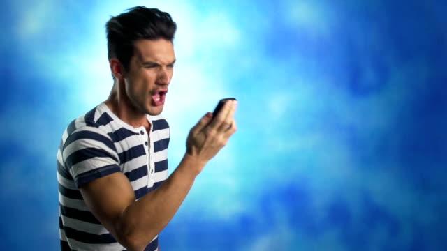 Upset man yelling in mobile phone