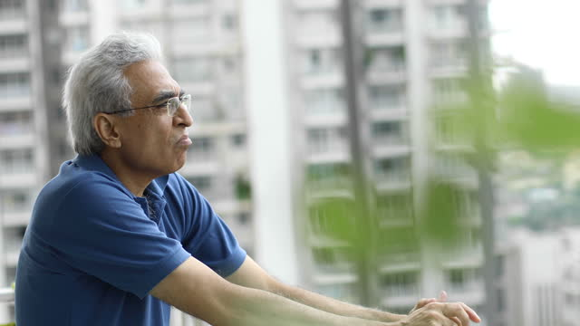 upset senior man admiring view from balcony - adult stock videos & royalty-free footage