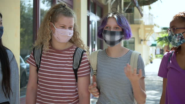 upset teen girl walking, talking to friends, with masks - 12 13 years stock videos & royalty-free footage