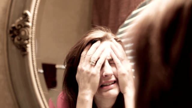 upset woman crying in mirror - guilt stock videos & royalty-free footage