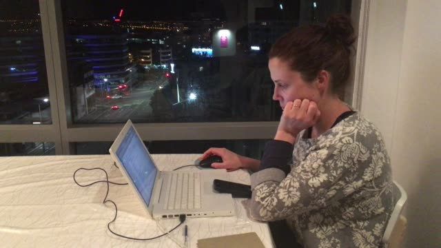 Upset woman works late at night from home