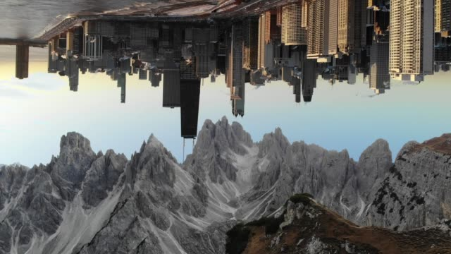 vidéos et rushes de upside down of surreal view merging alps mountain landscape with the reverse view of chicago skyline. - environnement
