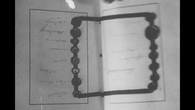 upside down views of the treaty of versailles hand turns pages showing numerous signatures wax seals and ribbons - versailles video stock e b–roll