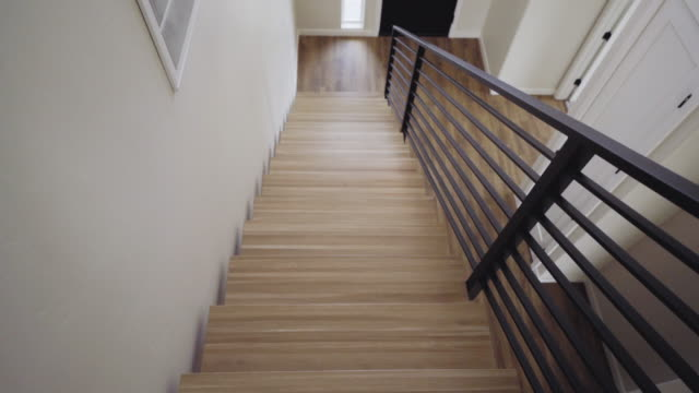 upstairs downward looking view of a grand entrance in a new custom modern residential home - flooring stock videos & royalty-free footage