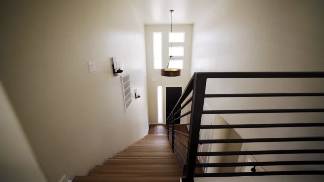 upstairs downward looking view of a grand entrance in a new custom modern residential home - doorway stock videos & royalty-free footage