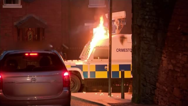 upsurge of violence in northern ireland puts focus on paramilitary groups northern ireland londonderry various of police land rover struck by petrol... - ロンドンデリー点の映像素材/bロール