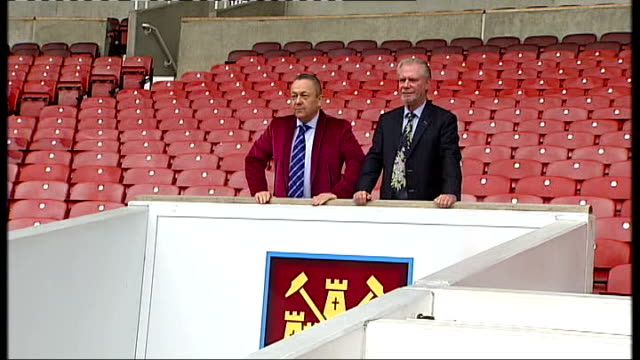 EXT Sullivan and Gold posing for photocall in the stands at West Ham United FC