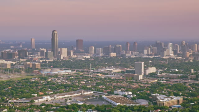 aerial uptown houston with williams tower rising above it - aerial stock videos & royalty-free footage