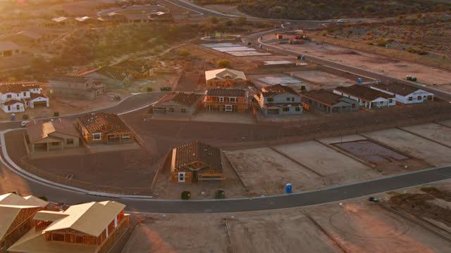 upward tilting drone flight over suburban homes under construction near tucson - construction site stock videos & royalty-free footage